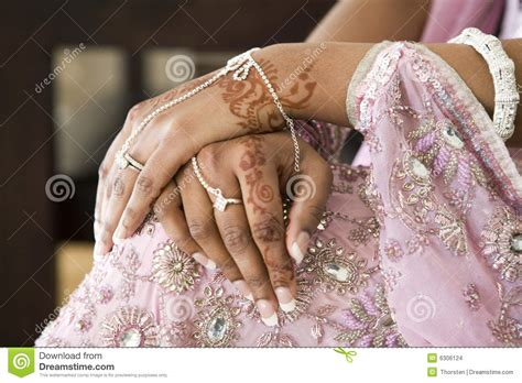 bride s hand with henna tattoo indian wedding stock