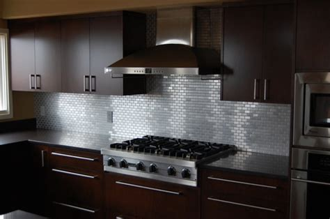 stainless 1x2 backsplash pebble tile installation at the