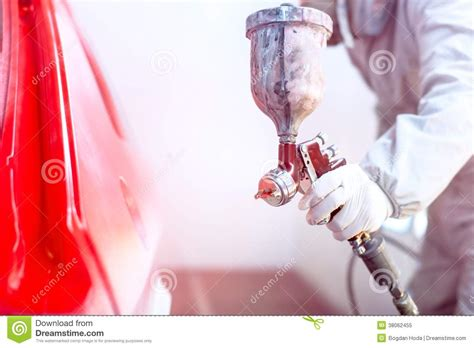 spray painting for free up of spray gun with paint painting a car stock