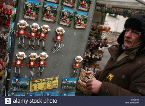 vendor puts mozart fridge magnet souvenirs in a souvenir shop in the stock photo royalty free