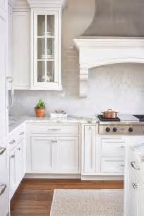 white and gray kitchen with light gray mini subway tiles