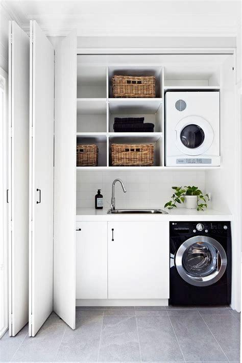 best 25 small laundry ideas on utility room ideas small laundry space and laundry room