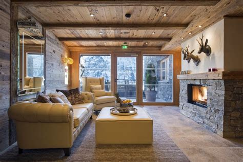 Chalet Fireplace by Luxury Chalet Uberhaus In Lech