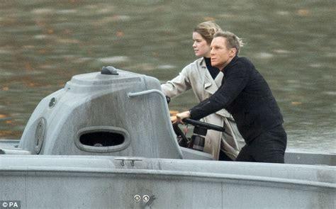 lea seydoux look alike daniel craig takes to the water as he films james bond