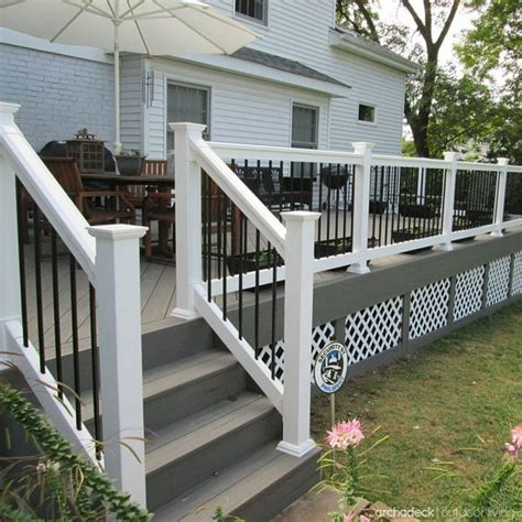 gray deck slightly raised above grade level this deck design includes low maintenance timbertech gray