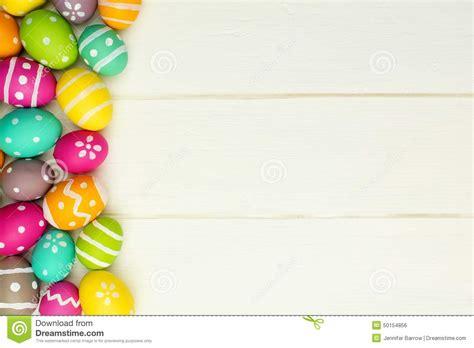Decorative Easter Eggs Home Decor by Easter Egg Side Border Against White Wood Stock Photo