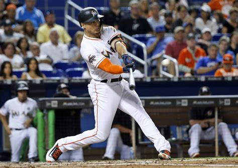it s official giancarlo stanton now slugging for the new