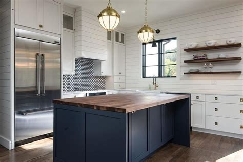 dark blue island   walnut countertop stands
