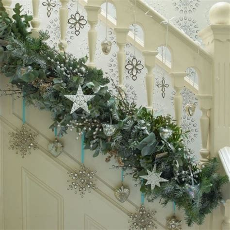 christmas garland on banister deck the halls 10 christmas hallway decorating ideas