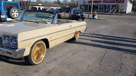 gold 64 impala 1964 impala on 20 quot daytons vogues