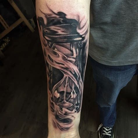 forearm hourglass tattoo chronic ink