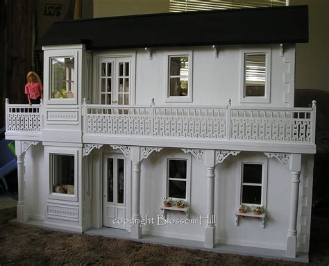 6 dollhouse dolls doll house another view of one of the doll houses