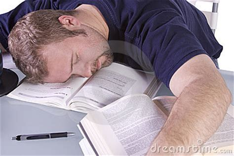 Student Sleeping On Desk by College Student Sleeping On His Desk Stock Photos Image