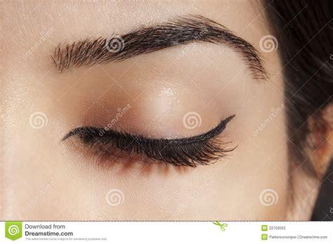 with eyeliner eyeliner on closed eye stock photo image of eyebrow