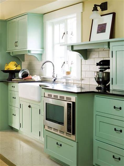 light green kitchen cabinets seafoam green and a craftsman galley kitchen update