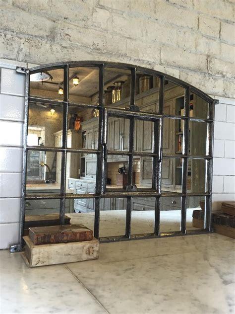 slow arch cast iron window frame mirror architectural