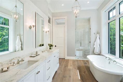 rustic wide plank wood floors with white bath vanity