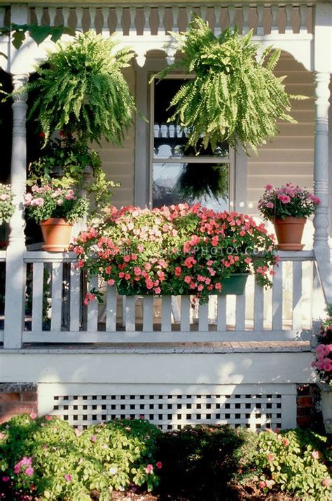 curb appeal container garden  victorian style house