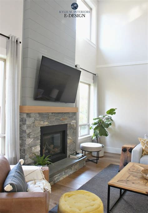 living room stone fireplace shiplap tv tall ceilings