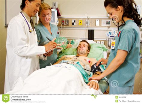 patient in emergency room health professionals with patient royalty free stock photos image 33490538
