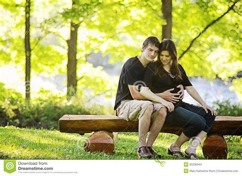 couple sitting on bench loving pregnant couple stock images image 35236944