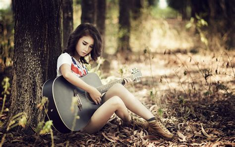 who is the asian girl in the mobile strike commercial asian guitar girl sitting trees wallpaper girls