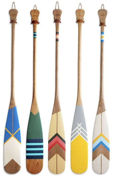 how to hang oars or paddles in an x shape the inspired pinterest picks pendelton blankets oar decor and canoe