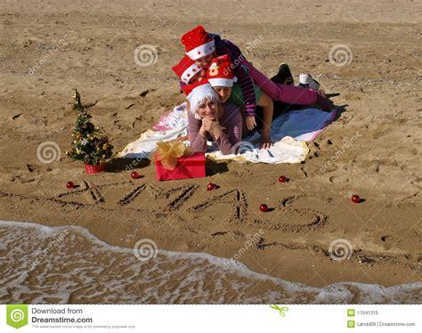 christmas family  sand beach royalty  stock photo image