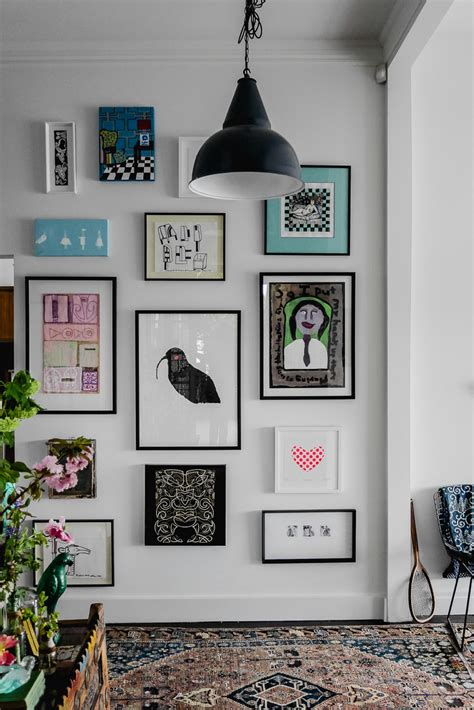 how to hang art on wall perfectly imperfect living hanging a gallery art wall