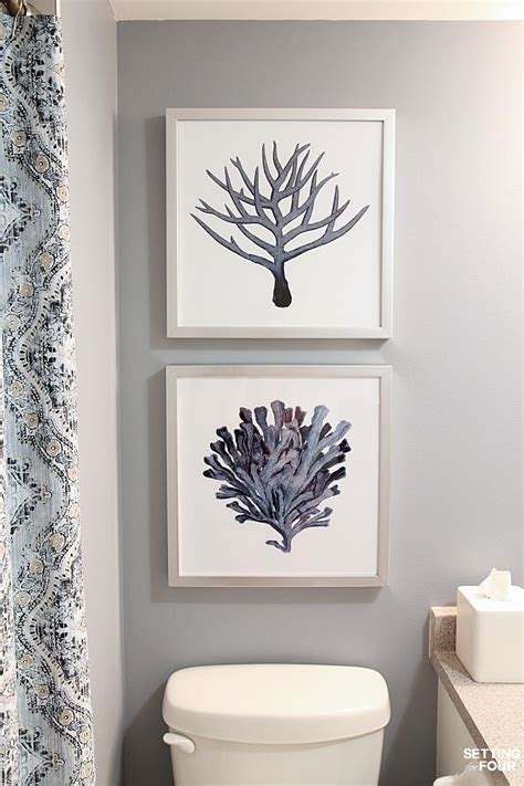 pictures to hang in bathroom height measurements and how to hang pictures in a bathroom