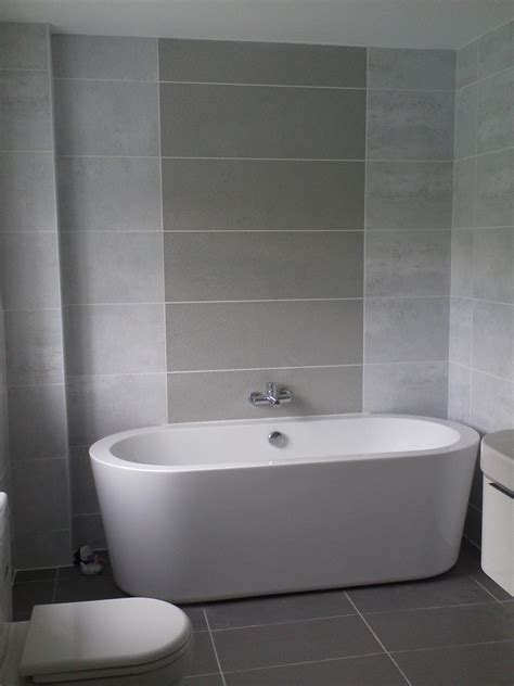 Bathroom Tile Ideas White Awesome Small Space Grey Bathroom Added Oval White Tub Also Grey Wall Tile In Modern Decors