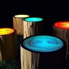 glow in the painted logs tree stump chairs and table complete with drink