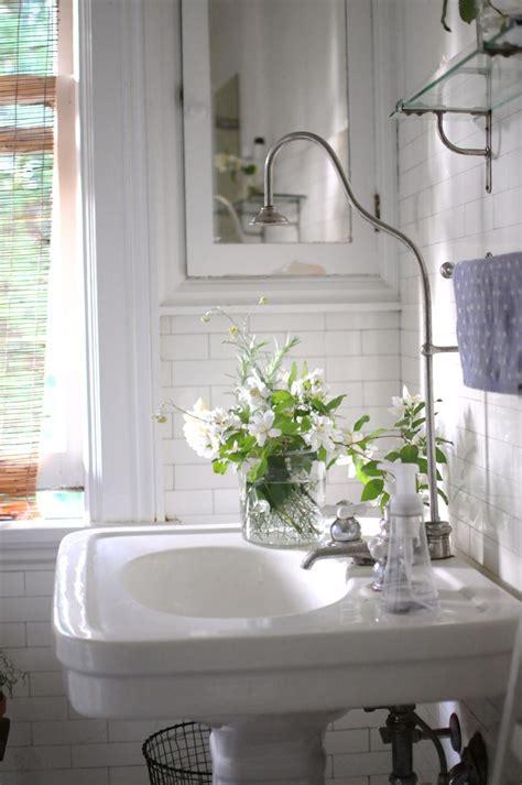 flowers in the bathroom put pedestal sinks on a pedestal tilejunket