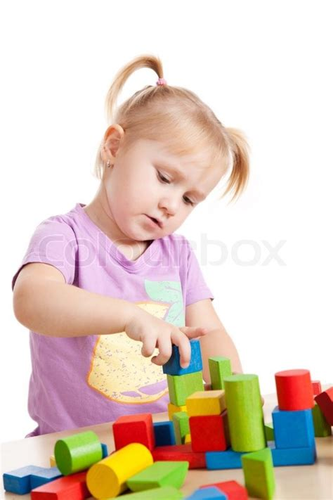 Build House Plans Online Free studio shot of little girl playing with toy blocks stock
