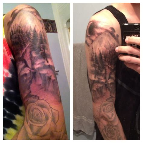 quarter sleeve mountain tattoo love the top half not fond of the roses though body art