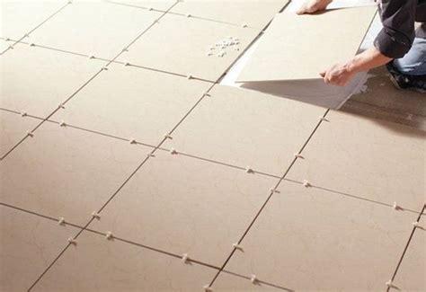 where do you start tiling the flooring from quora