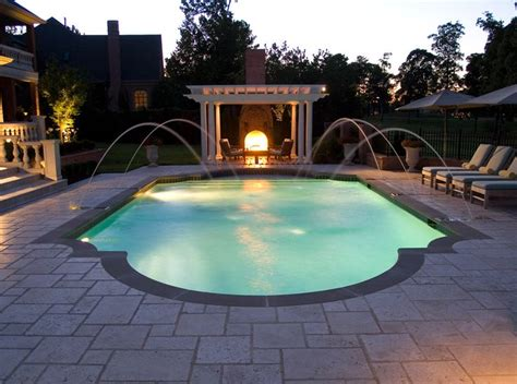 roman pool designs night view of roman style swimming pool with deck jets