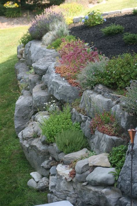 garden rock walls 25 best ideas about sloped front yard on