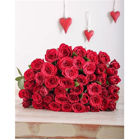 valentines day red roses red roses in cellophane for valentine s day inmotion flowers