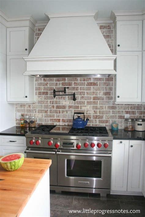 brick backsplash and copper hood would look great with 190 best range hoods images on pinterest kitchen range