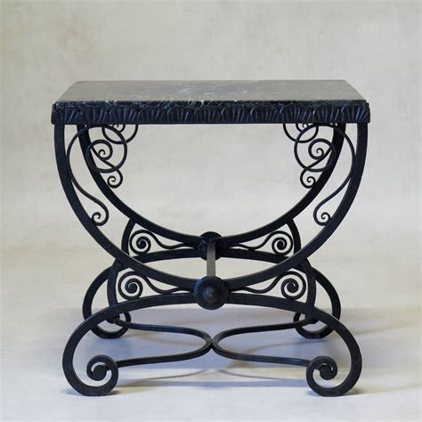 small deco wrought iron table with green marble top