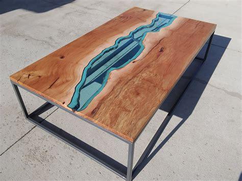 hand  sycamore river glass coffee table  villella