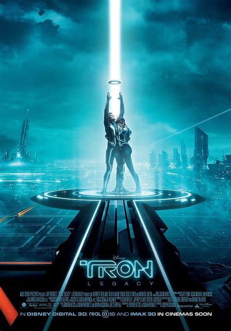 film tron legacy adalah tron legacy movie poster triptych garret hedlund olivia