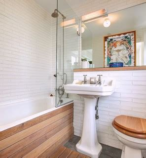 small cream panelled bathroom with birdcage small shoreditch townhouse eclectic bathroom london by