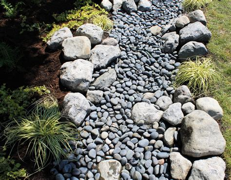 water and stone dry riverbed garden traditional