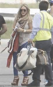 Other Designers Hilary Duff With Designer Travel Bags by Hilary Duff And Mike Comrie Take Baby Luca On A