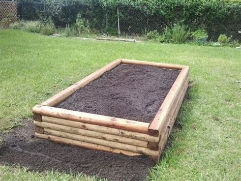 Using Landscape Timbers To Build A Flower Bed 12 Diy Raised Garden Bed Ideas