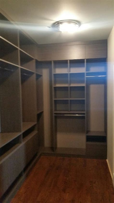 sweet walk in closet in east lakeview closet outfitters