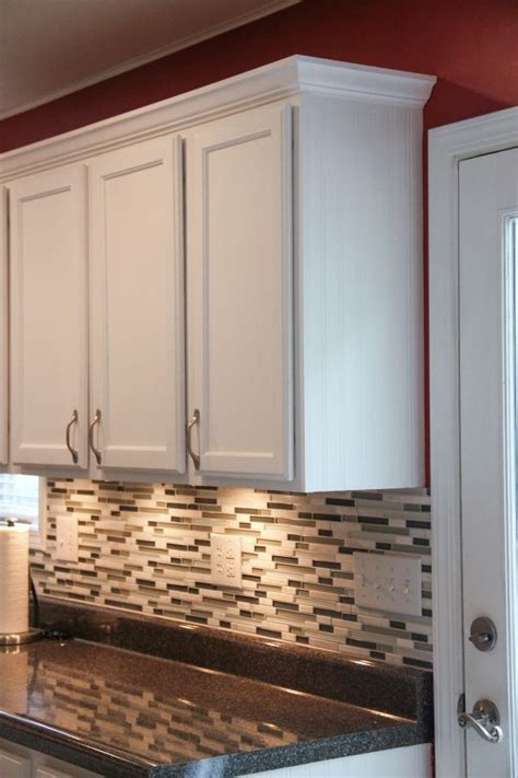 molding on top of kitchen cabinets budget kitchen makeover laminate countertops