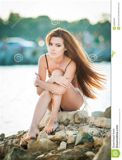 Hair Outside Bathing Suit Pictures   beautiful woman with long hair in bathing suit sitting on